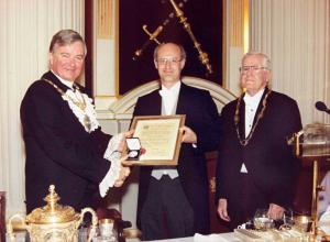 Professor McKinnon receiving the Herbert Crow award